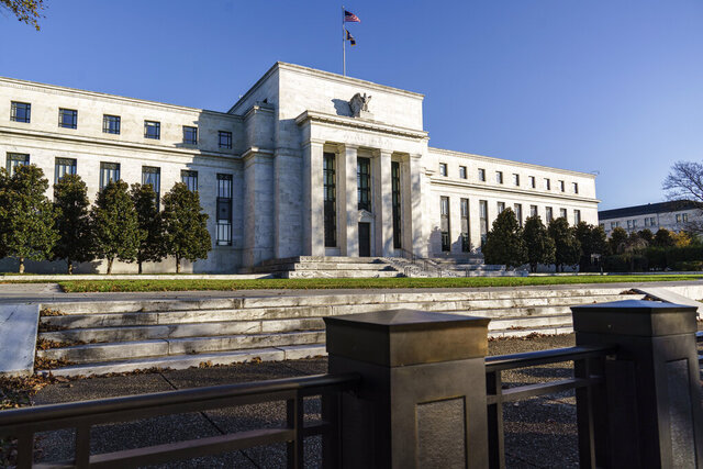 FILE - This Monday, Nov. 16, 2020 file photo shows the Federal Reserve in Washington. The Federal Reserve said Friday, Dec. 18, 2020 that the 33 largest U.S. banks are in strong shape despite the pandemic's economic shock. (AP Photo/J. Scott Applewhite, File)