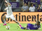 Orlando City's Nani, right, trips CF Montreal;s Joaquin Torres, resulting in a yellow card being issued to Nani during an MLS soccer match in Orlando, Fla., Wednesday, Sept. 15, 2021. (Stephen M. Dowell/Orlando Sentinel via AP)