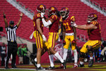 Southern California wide receiver Drake London (15) celebrates with teammates Bru McCoy (4), Tyler Vaughns (21) and Justin Dedich (57) after catching a pass in the end zone for a touchdown against Arizona State during an NCAA football game Saturday, Nov. 7, 2020, in Los Angeles. USC won 28-27. (AP Photo/Ashley Landis)