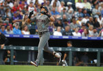 Arizona Diamondbacks' David Peralta gesture as he circles the bases after hitting a two-run home run off Colorado Rockies starting pitcher Jeff Hoffman in the second inning of a baseball game Tuesday, Aug. 13, 2019, in Denver. (AP Photo/David Zalubowski)