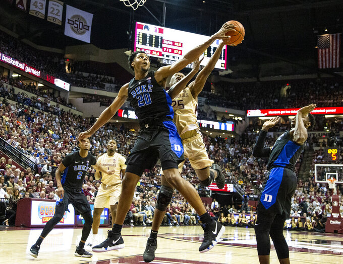 Duke center Marques Bolden (20) blocks the shot of Florida State forward Mfiondu Kabengele in the second half of an NCAA college basketball game in Tallahassee, Fla., Saturday, Jan. 12, 2019. Duke defeated Florida State 80-78. (AP Photo/Mark Wallheiser)