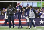 England Patriots wide receiver Josh Gordon is assisted from the field after an injury in the first half of an NFL football game against the New York Giants, Thursday, Oct. 10, 2019, in Foxborough, Mass. (AP Photo/Elise Amendola)