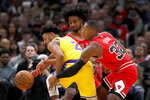 Los Angeles Lakers' Quinn Cook (2) is double-teamed by Chicago Bulls' Coby White, center, and Kris Dunn during the second half of an NBA basketball game Tuesday, Nov. 5, 2019, in Chicago. The Lakers won 118-112. (AP Photo/Charles Rex Arbogast)
