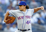 New York Mets starting pitcher Jason Vargas winds up during the first inning of the team's baseball game against the New York Yankees, Tuesday, June 11, 2019, in New York. (AP Photo/Kathy Willens)