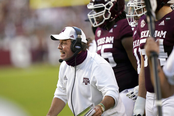 Texas A&M coach Jimbo Fisher yells to his players during the first half of an NCAA college football game against Vanderbilt Saturday, Sept. 26, 2020, in College Station, Texas. (AP Photo/David J. Phillip)