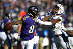 Baltimore Ravens quarterback Lamar Jackson (8) tries to break free from Los Angeles Chargers free safety Derwin James in the first half of an NFL wild card playoff football game, Sunday, Jan. 6, 2019, in Baltimore. (AP Photo/Nick Wass)