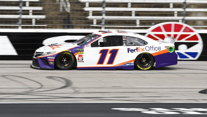 Driver Denny Hamlin races down the front stretch during practice for a NASCAR Cup auto race at Texas Motor Speedway, Saturday, March 30, 2019, in Fort Worth, Texas. (AP Photo/Larry Papke)