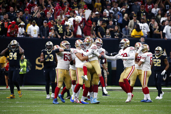 San Francisco 49ers kicker Robbie Gould (9) celebrates his game winning field goal with his team at the end of regulation in the second half an NFL football game against the New Orleans Saints in New Orleans, Sunday, Dec. 8, 2019. The 49ers won 48-46. (AP Photo/Butch Dill)