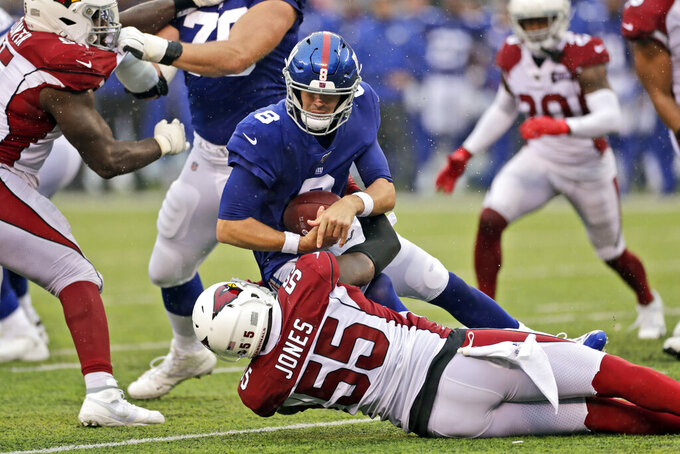 Arizona Cardinals' Chandler Jones (55) sacks New York Giants quarterback Daniel Jones (8) during the second half of an NFL football game, Sunday, Oct. 20, 2019, in East Rutherford, N.J. (AP Photo/Adam Hunger)