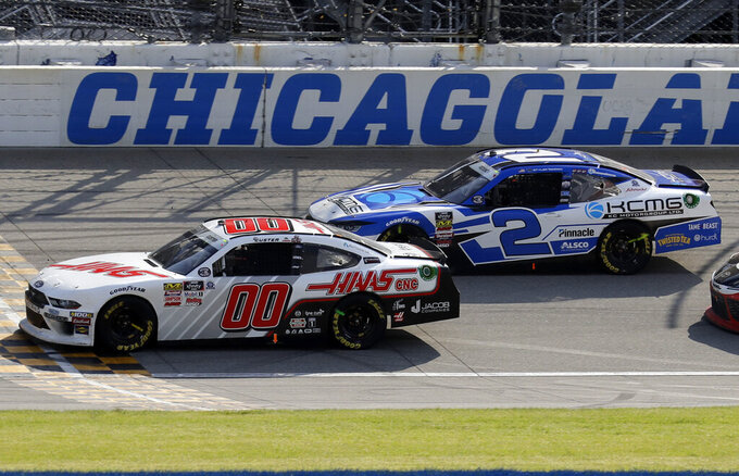 Cole Custer, left, drives past Tyler Reddick during the NASCAR Xfinity Series auto race at Chicagoland Speedway in Joliet, Ill., Saturday, June 29, 2018. (AP Photo/Nam Y. Huh)