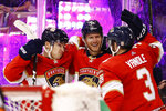 Florida Panthers center Frank Vatrano, left, defenseman Mark Pysyk, center, and Keith Yandle, right, celebrate after Vatrano scored during the second period of the team's NHL hockey game against the Los Angeles Kings, Thursday, Jan. 16, 2020, in Sunrise, Fla. (AP Photo/Brynn Anderson)