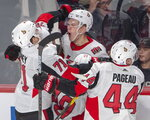 Ottawa Senators left wing Brady Tkachuk, centre, celebrates with teammates after scoring the winning goal during overtime NHL hockey action against the Montreal Canadiens, in Montreal, Wednesday, Nov. 20, 2019. (Ryan Remiorz/The Canadian Press via AP)