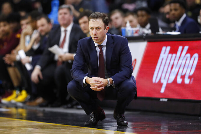 FILE - Minnesota head coach Richard Pitino watches from the bench during the second half of an NCAA college basketball game against Iowa, in Iowa City, Iowa in this Monday, Dec. 9, 2019, file photo. As coach Richard Pitino starts a pivotal eighth year at Minnesota, the Gophers will again try to bounce back from a bad season after finishing in 12th place in the Big Ten in 2019-20. (AP Photo/Charlie Neibergall, File)