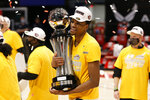 St. Bonaventure's Osun Osunniyi celebrates with the trophy after beating VCU in an NCAA college basketball championship game for the Atlantic Ten Conference tournament Sunday, March 14, 2021, in Dayton, Ohio. St. (AP Photo/Jay LaPrete)