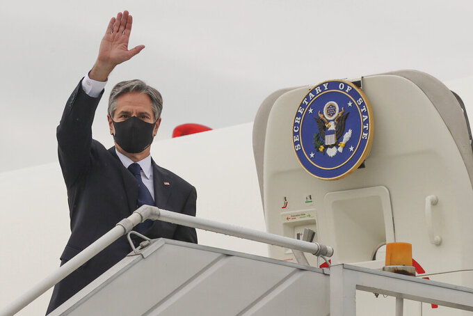 Secretary of State Antony Blinken waves farewell as he boards his plane at New Delhi Palam Airport to depart for Kuwait from New Delhi, India, Wednesday, July 28, 2021. (Jonathan Ernst/Pool via AP)