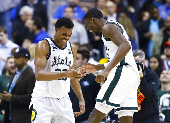 Michigan State forward Xavier Tillman, left, and teammate Gabe Brown, right, celebrate after the team's 80-63 win over LSU during an NCAA men's college basketball tournament East Region semifinal in Washington, Friday, March 29, 2019. (AP Photo/Alex Brandon)