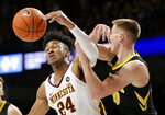 Iowa guard Joe Wieskamp (10) and Minnesota forward Eric Curry (24) vie for the ball during the first half of an NCAA college basketball game Sunday, Jan. 27, 2019, in Minneapolis. (AP Photo/Andy Clayton-King)