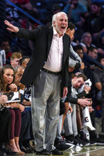 San Antonio Spurs coach Gregg Popovich stands on the sideline during the first half of a preseason NBA basketball game against the Atlanta Hawks in Atlanta, Wednesday, Oct. 10, 2018. (AP Photo/Danny Karnik)