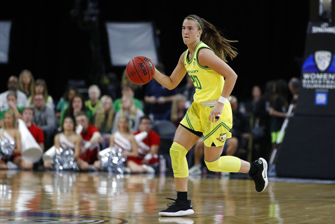 FILE - In this March 6, 2020, file photo, Oregon's Sabrina Ionescu (20) plays against Utah in an NCAA college basketball game in the quarterfinal round of the Pac-12 women's tournament in Las Vegas. The Associated Press had a panel of WNBA coaches and general managers hold a mock draft. (AP Photo/John Locher, File)