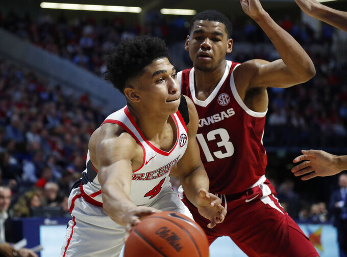 Mississippi guard Breein Tyree (4) dribbles past Arkansas guard Mason Jones (13) during the second half of the NCAA college basketball game in Oxford, Miss., Saturday, Jan. 19, 2019. Mississippi won 84-67. (AP Photo/Rogelio V. Solis)