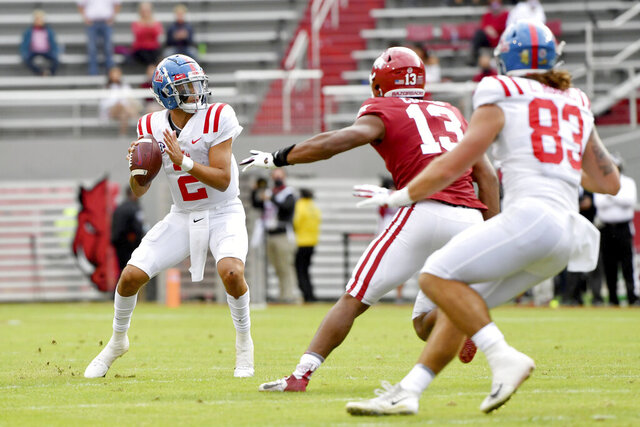 Mississippi quarterback Matt Corral (2) drops back to pass against Arkansas during the second half of an NCAA college football game Saturday, Oct. 17, 2020, in Fayetteville, Ark. (AP Photo/Michael Woods)