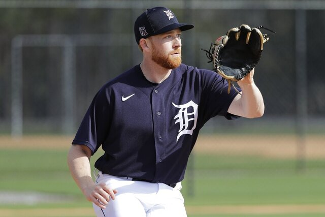 FILE - In this Feb. 15, 2020, file photo, Detroit Tigers' Spencer Turnbull takes part in a drill during a spring training baseball workout in Lakeland, Fla. Christin Stewart homered in the top of the 10th inning to lift Detroit to a win in its season opener last year. A few days later, Spencer Turnbull took the mound for the Tigers as the starting pitcher for their first home game. Those are moments each player can look back on with pride, but both enter 2020 with a lot still to prove. (AP Photo/Frank Franklin II, File)