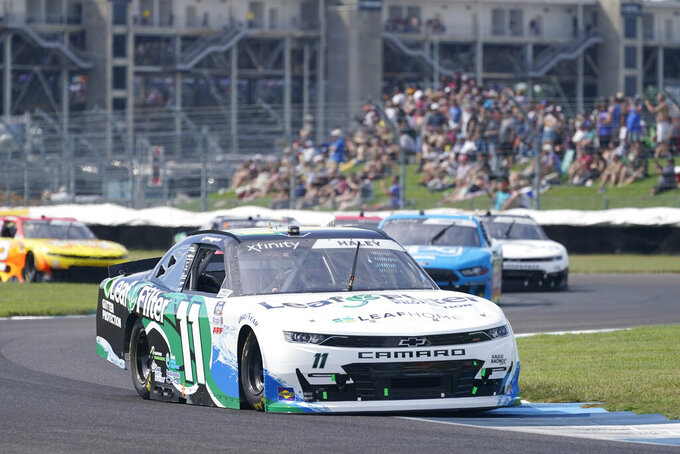 Justin Haley drives into a turn during a NASCAR Xfinity Series auto race at Indianapolis Motor Speedway, Saturday, Aug. 14, 2021, in Indianapolis. (AP Photo/Darron Cummings)