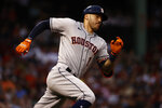Houston Astros' Carlos Correa runs out an RBI double against the Boston Red Sox during the second inning of a baseball game Tuesday, June 8, 2021, at Fenway Park in Boston. (AP Photo/Winslow Townson)