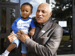 Mississippi Democratic Senatorial candidate Mike Espy, who is seeking to unseat appointed U.S. Sen. Cindy Hyde-Smith, R-Miss., hoists his grandson Ryan Galloway on his shoulders after voting, Tuesday, Nov. 6, 2018 in Ridgeland, Miss.  (AP Photo/Rogelio V. Solis)