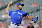 Toronto Blue Jays starting pitcher Wilmer Font throws to a Baltimore Orioles batter during the second inning of a baseball game, Friday, Aug. 2, 2019, in Baltimore. (AP Photo/Julio Cortez)