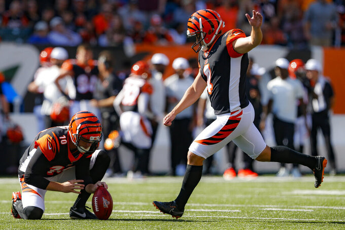 Cincinnati Bengals kicker Randy Bullock (4) boots an extra point in the first half of an NFL football game against the Jacksonville Jaguars, Sunday, Oct. 20, 2019, in Cincinnati. (AP Photo/Gary Landers)