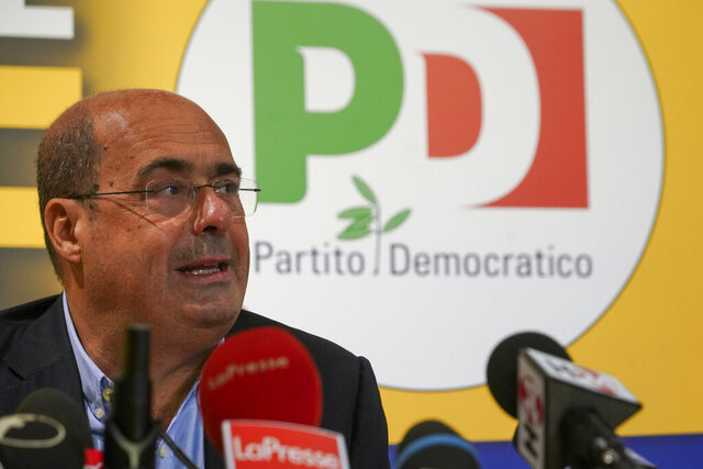 Democratic Party leader Nicola Zingaretti talks to the media during a press conference, in Rome, Monday, Sept. 21, 2020. On Sunday and Monday Italians voted nationwide in a referendum to confirm a historical change to the country's constitution to drastically reduce the number of Members of Parliament from 945 to 600. Eighteen million of Italian citizens will also vote on Sunday and Monday to renew local governors in seven regions, along with mayors in approximately 1,000 cities. (AP Photo/Andrew Medichini)