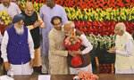 FILE- In this May 25, 2019 file photo,Indian Prime Minister Narendra Modi, center, hugs Shiv Sena party chief Uddhav Thackeray after being elected as Bharatiya Jananta Party and ruling alliance leader, in New Delhi, India. Indian Prime Minister Narendra Modi's governing party has suffered a big setback in western Maharashtra state after its longtime ally broke away and joined two other parties to form the new state government. (AP Photo/Manish Swarup, File)