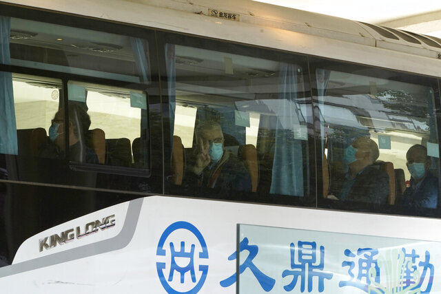 Members from the World Health Organization team of experts prepare to leave on a bus after ending their quarantine at a hotel in Wuhan in central China's Hubei province on Thursday, Jan. 28, 2021. (AP Photo/Ng Han Guan)