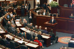 """In this Sept. 17, 2019 photo, State Rep. Chris Sprowls, 35, addresses the Florida House of Representatives in Tallahassee, Fla., after the Republican was elected to lead the 120-member chamber. In his first 10 months in office, Florida Gov. Ron DeSantis has appointed a science officer, established a czar on climate change and pushed action against red tide and algae blooms. """"This isn't about the next election, this is about the next several decades and what our environment is going to look like for our children and grandchildren,"""" said GOP state Rep. Chris Sprowls, who, at 35, is poised to helm Florida's House of Representatives next fall and whose district northwest of Tampa lies along the Gulf Coast.  (AP Photo/Bobby Caina Calvan)"""