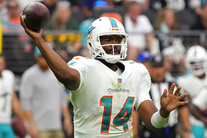 Miami Dolphins quarterback Jacoby Brissett (14) throws against the Las Vegas Raiders during the second half of an NFL football game, Sunday, Sept. 26, 2021, in Las Vegas. (AP Photo/Rick Scuteri)