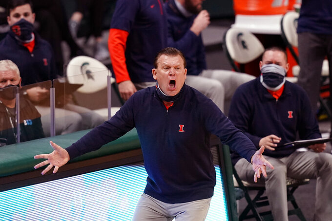 Illinois head coach Brad Underwood reacts after a play during the first half of an NCAA college basketball game against Michigan State, Tuesday, Feb. 23, 2021, in East Lansing, Mich. (AP Photo/Carlos Osorio)