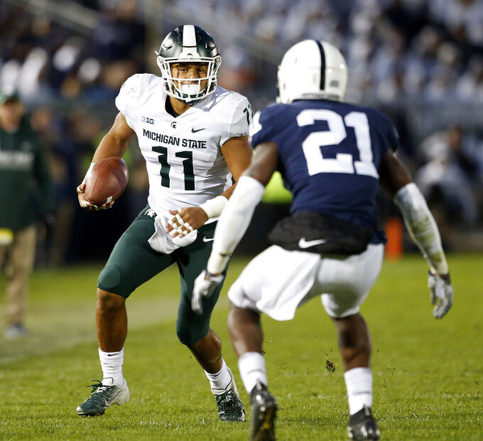Michigan State's Connor Heyward (11) looks to take on Penn State's Amani Oruwariye (21) after a catch during the second half of an NCAA college football game in State College, Pa., Saturday, Oct. 13, 2018. (AP Photo/Chris Knight)