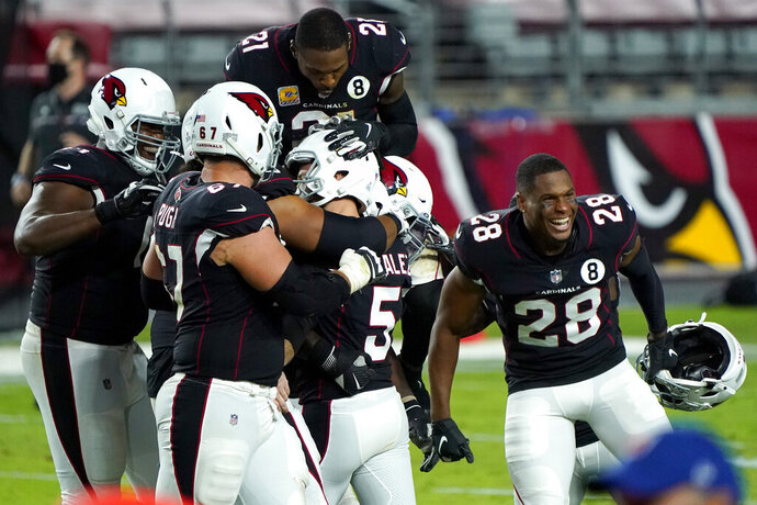 Arizona Cardinals kicker Zane Gonzalez (5) celebrates his game-winning field goal with teammates after an NFL football game against the Seattle Seahawks, Sunday, Oct. 25, 2020, in Glendale, Ariz. The Cardinals won 37-34 in overtime. (AP Photo/Rick Scuteri)