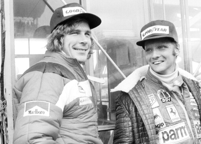 "FILE - In this Oct. 24, 1976, file photo, Austrian auto racer Niki Lauda, right, defending champion in world driving, and James Hunt, of Britain, look at the rain before the start of the Japan Grand Prix Formula One auto race at Fuji International Speedway, Gotemba, Japan. Three-time Formula One world champion Niki Lauda, who won two of his titles after a horrific crash that left him with serious burns and went on to become a prominent figure in the aviation industry, has died. He was 70. The Austria Press Agency reported Lauda's family saying in a statement he ""passed away peacefully"" on Monday, May 20, 2019. (AP Photo/Nick Ut, File)"