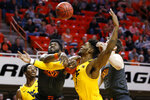 West Virginia forward Derek Culver (1) is fouled by Oklahoma State guard Jonathan Laurent, front left, in the first half of an NCAA college basketball game in Stillwater, Okla., Monday, Jan. 6, 2020. (AP Photo/Sue Ogrocki)
