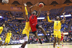 FILE - Austin Peay guard Terry Taylor (21) drives to the basket as West Virginia forward Derek Culver, behind, and West Virginia forward Gabe Osabuohien (3) defend during the first half of an NCAA college basketball game in Morgantown, W.Va., in this Thursday, Dec. 12, 2019, file photo. Taylor, the reigning Ohio Valley Conference player of the year, averaged 21.8 points and 11 rebounds last season and is the first player in school history to score at least 500 points in three consecutive seasons. (AP Photo/Kathleen Batten, File)