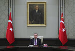 FILE - In this April 26, 2021, file photo, Turkey's President Recep Tayyip Erdogan, backdropped by a painting depicting modern Turkey's founder Mustafa Kemal Ataturk, chairs his government's cabinet in Ankara, Turkey. President Joe Biden and Turkish counterpart Erdogan have known each other for years, but their meeting Monday, June 14, 2021, will be their first as heads of state. And it comes at a particularly tense moment for relations between their two countries. (Turkish Presidency via AP, File)