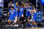 UCLA players react to a play against Alabama in overtime duiring a Sweet 16 game in the NCAA men's college basketball tournament at Hinkle Fieldhouse in Indianapolis, Sunday, March 28, 2021. (AP Photo/AJ Mast)