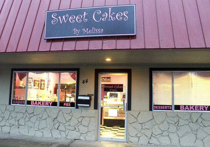 FILE- This Feb. 5, 2013, file photo, shows exterior of the now closed Sweet Cakes by Melissa in Gresham, Ore.  The Supreme Court is throwing out an Oregon court ruling against bakers who refused to make a wedding cake for a same-sex couple. The move keeps the high-profile case off the court's election-year calendar and orders state judges to take a new look at the dispute between the lesbian couple and the owners of a now-closed bakery. The justices already have agreed to decide whether federal civil rights law protects people from job discrimination due to their sexual orientation or gender identity.  (Everton Bailey Jr./The Oregonian via AP)