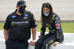 Hailie Deegan, right, talks to a crew member prior to the start of the NASCAR Truck Series auto race at Richmond International Raceway in Richmond, Va., Saturday, April 17, 2021. (AP Photo/Steve Helber)