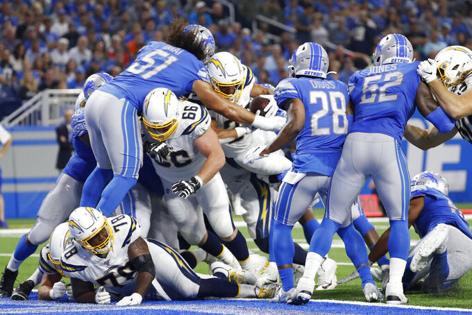 Too many mistakes for short-handed Chargers in loss to Lions