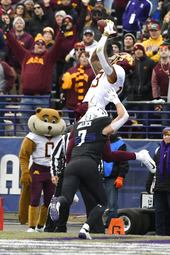 Morgan's 4 TD passes lead No. 11 Gophers past Wildcats 38-22
