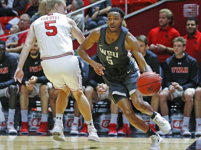 Washington State forward Marvin Cannon, right, drives around Utah guard Parker Van Dyke, left, during the first half of an NCAA college basketball game Saturday, Jan. 12, 2019, in Salt Lake City. (AP Photo/Rick Bowmer)
