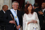 Argentina's President Alberto Fernandez, left, and Vice President Cristina Fernandez de Kirchner smile after taking the oath of office at the Congress in Buenos Aires, Argentina, Tuesday, Dec. 10, 2019. (AP Photo/Natacha Pisarenko)